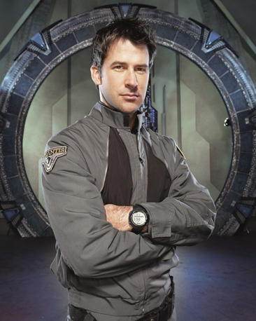 Celebrity Fan Fest special guest Joe Flanigan crossing his arms and standing in front of
